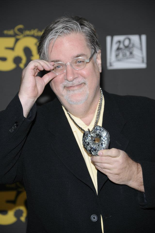 matt groening with cast donut at simpsons party hollywood roosevelt